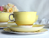 yellow tea cup, saucer and plate made by Colclough
