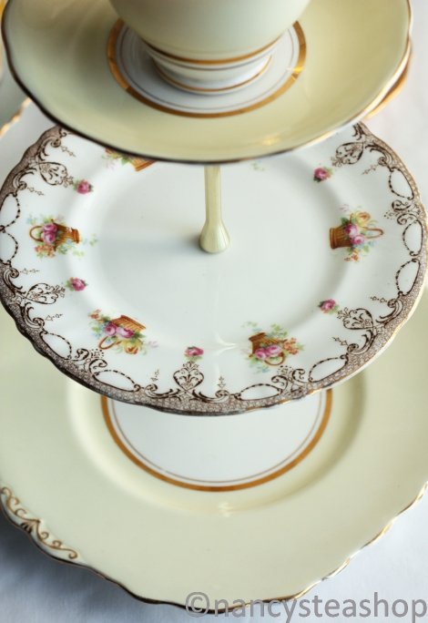 Three tier cake stand with vintage china plates