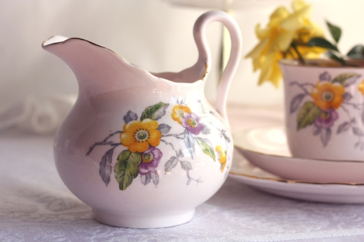 A picture of a peach coloured Tuscan English vintage china creamer or milk jug