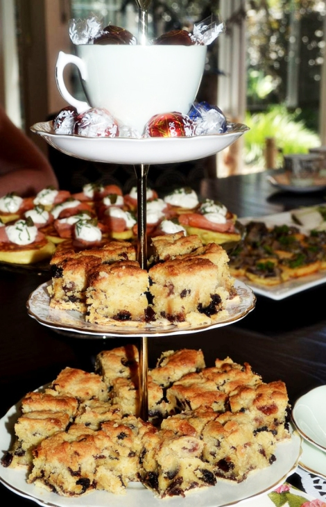 A photo of Cake stand with cakes and sweets