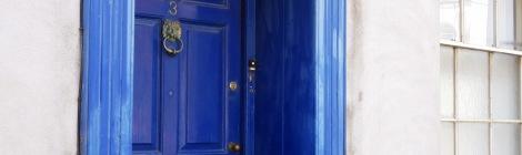 A photograph of a blue door way in Carmarthen