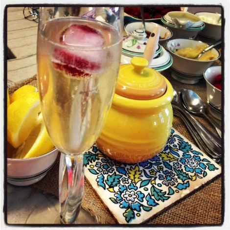 A photo of a champagne glass and vintage crockery