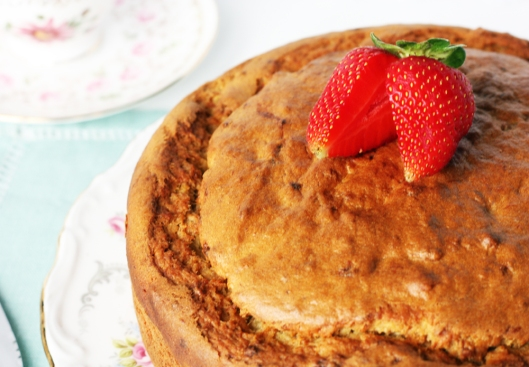 A close-up photo of the banana cake with a fresh strawberry on top