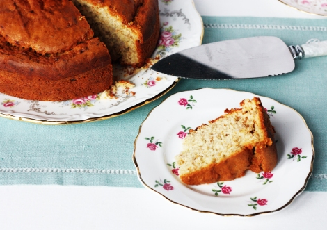 A photo of a slice of banana cake on a vintage china plate with a rosebuds pattern