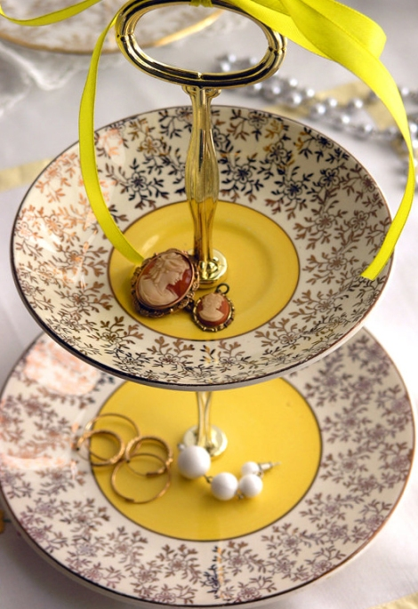 A photo of a yellow trinket stand made with English vintage china