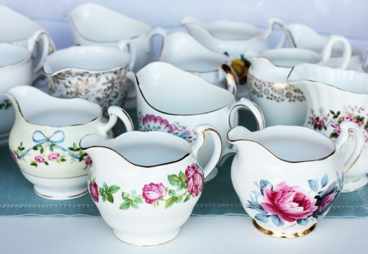 A photo of a group of vintage china jugs
