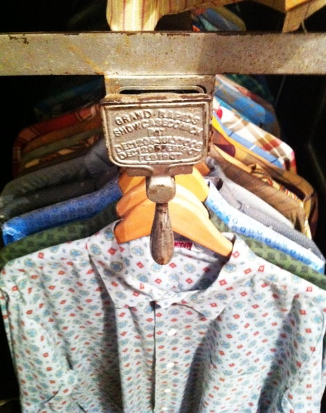 A photo of Vintage shirts hung in a vintage clothing shop in Boston