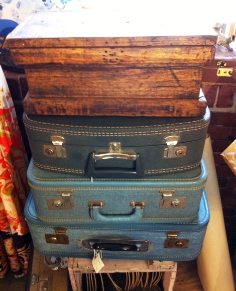 A photo of a stack of vintage luggage cases