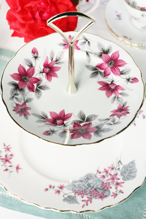A photo of a two tier cake stand made with English vintage china