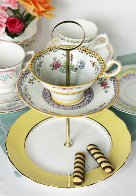 A photo of Yellow cake stand made with English vintage china