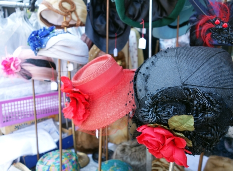 A picture of vintage hats outside a shop