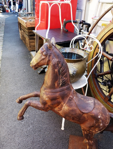 A picture of a vintage metal horse statue