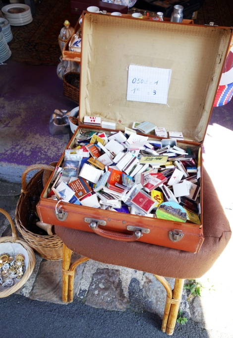 A picture of vintage matchboxes in a brown vintage suitcase