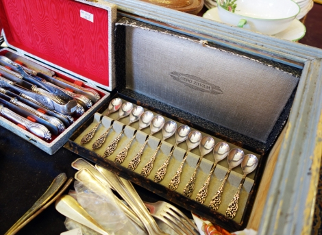 A photo of vintage silver spoons in a box