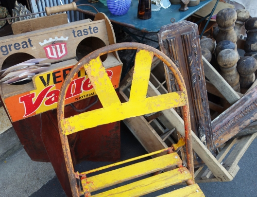 A picture of a vintage yellow wooden chair