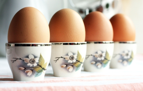 A photo of vintage Midwinter china egg cups and holder