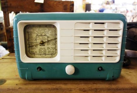 A turquoise vintage radio