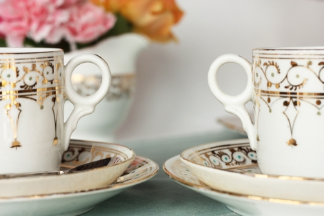 A picture of two vintage English china gold patterned cups