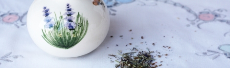 A picture of a small ceramic lidded pot with dried lavender