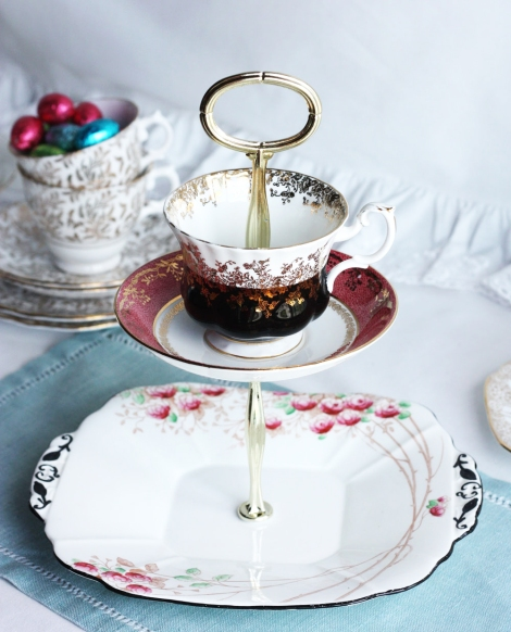 a picture of a two tier cake stand made from vintage English china
