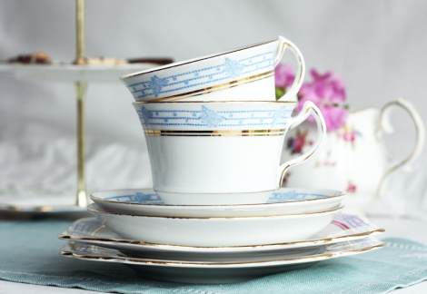 a picture of two vintage Melba china tea sets on a table