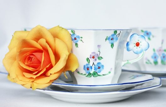 a picture of a vintage Melba china tea set with an orange flower