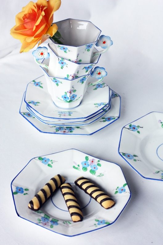 a picture of three vintage Melba china tea sets with an orange flower