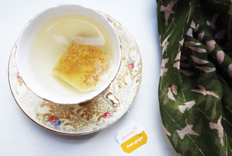 A picture of Pukka three ginger tea in a vintage tea cup