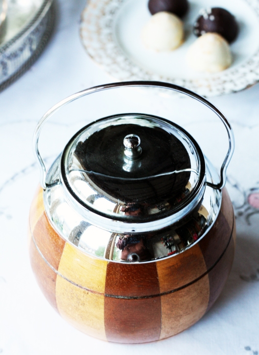 A photo of a wooden and chrome vintage tea caddy