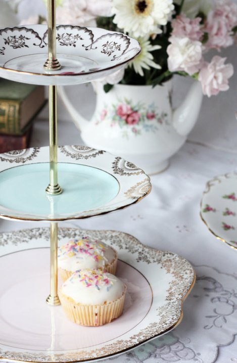 A photo of a Vintage English china cake stand 22kt gold